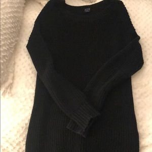 Black sweater dress with silver zippers